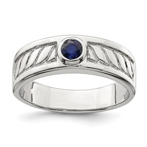Men's sterling silver ring, bezel set with a round, blue sapphire that weighs 2 cts. The band measures 6.95 mm and has a textured and polished finish.
