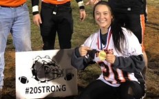 When the Bulldogs won the District IV title, Aubree accepted his award