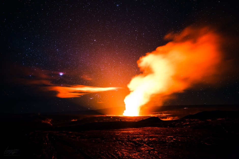 Volcanic Tides - Kilauea's summit caldera and Halema'uma'u crater glowing bright.