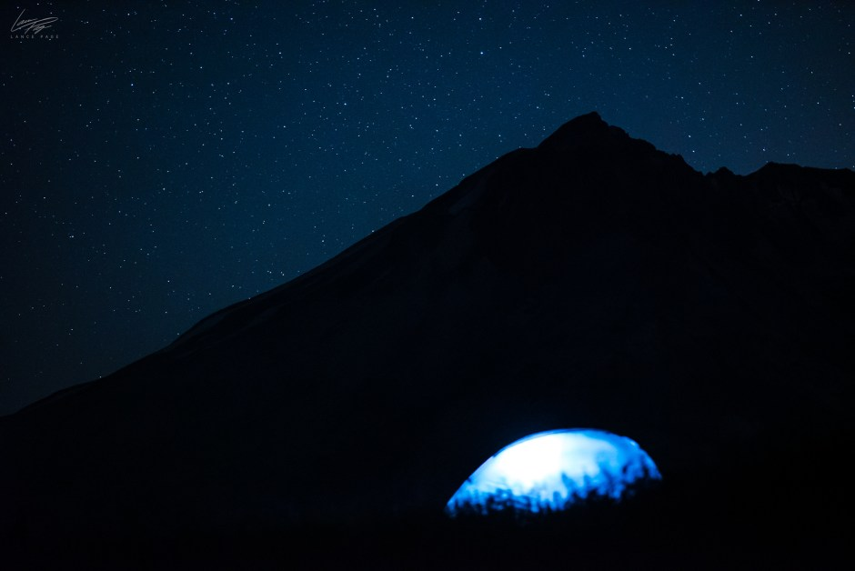 Tent lit up with Mt. St. Helens Peak