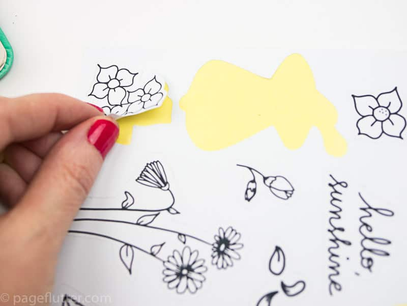 15 Printable Floral Planner Stickers to Beautify Your Entire Routine-5 | Floral planner sticker being peeled from sheet | pageflutter.com