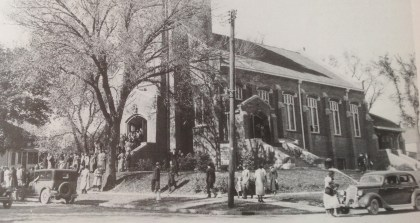 The young elms planted in the boulevard shortly after the church was dedicated had grown into majestic shade trees by spring in the mid-30's.
