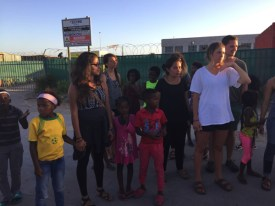 Photo 2. Exploring New Brighton township with many of the children.