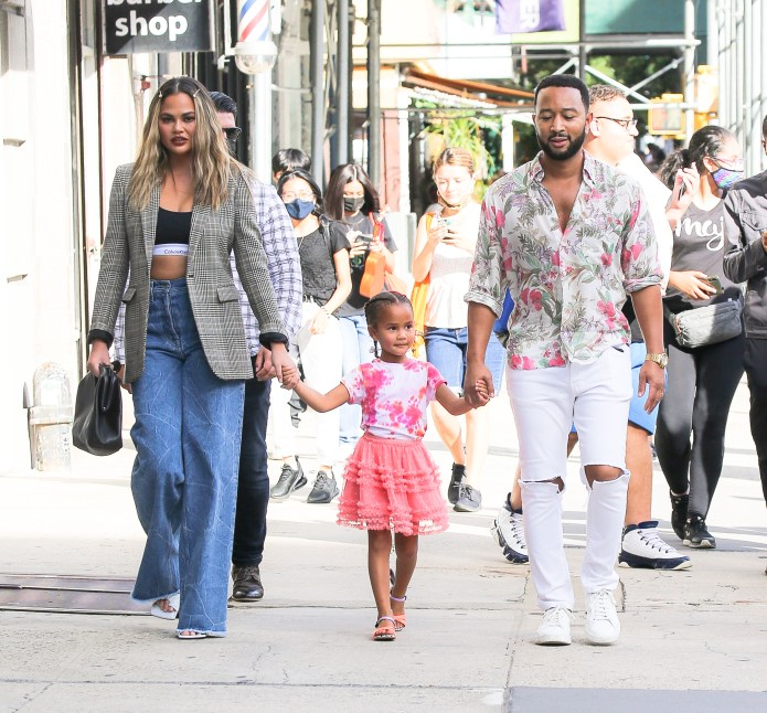 John Legend and Chrissy Teigen enjoy a walk with their daughter in NYC