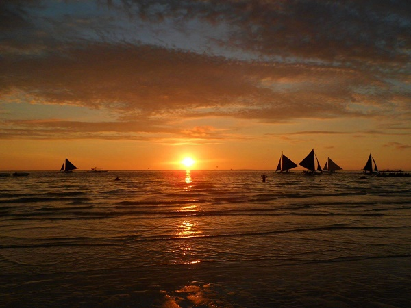 Beautiful sunset at White Beach on the island of Boracay, in the Philippines