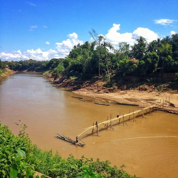 Mekong River and bamboo bridge building in Luang Prabang, Laos