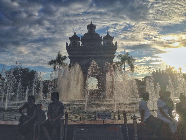 Patuxai and fountains at sunsets in Vietiane, Laos
