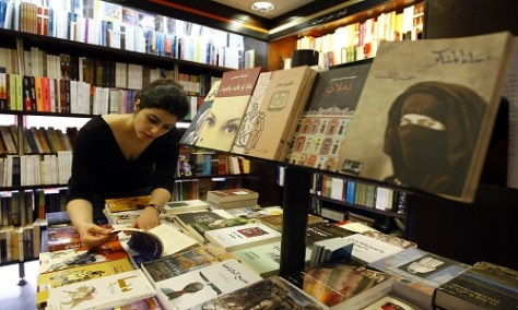 "A Lebanese university student browses an Arabic novel at a bookshop in Beirut on April 21, 2009. Beirut is to be nominated on April 23 as UNESCO ""World Book Capital for the year 2009"", at a time when the production of novels is booming in the Arab world, breaking taboos and prohibitions, but sorely missing readers. AFP PHOTO/JOSEPH BARRAK / AFP PHOTO / JOSEPH BARRAK"