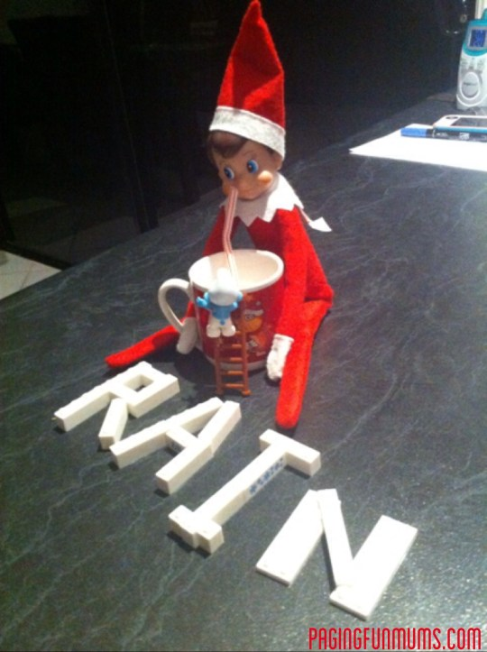 'Rain' enjoying a drink after spelling his name with Lego.