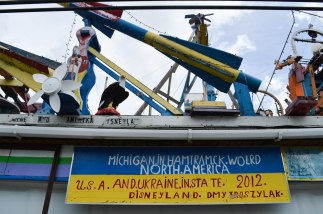 In the backyard of Dmytro Szylak's house in Hamtramck is his outdoor art exhibition called Disneyland. The sign reads U.S.A. and Ukraine because Szylak is an immigrant.