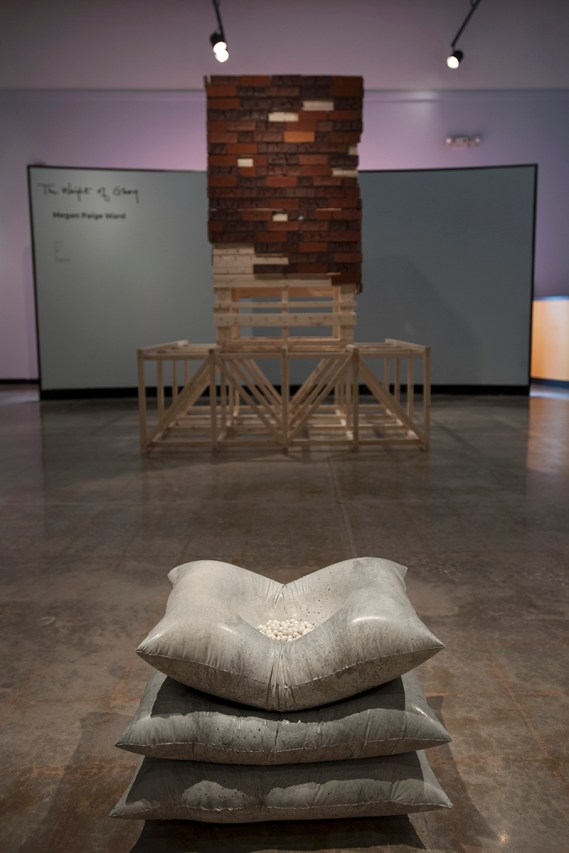 Gallery installation view with concrete pillows in focus