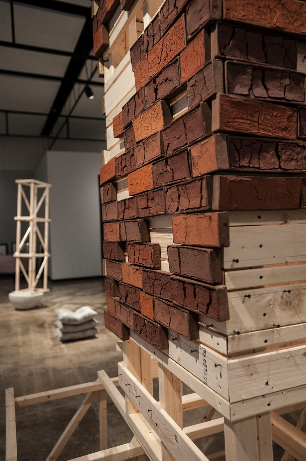 Detail of brick tower constructed of wood and handmade bricks made from soil in Frog Jump, TN