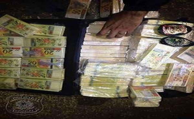 PF apreende mala com dinheiro falso