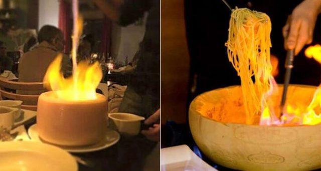 Onde comer macarrão dentro do queijo parmesão em São Paulo