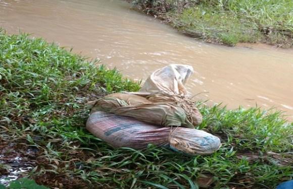 Jovem com pescoço cortado é achado amarrado dentro de sacos em rio de RO