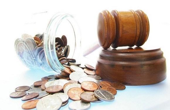 Beneficiária da Justiça gratuita deve arcar com custas por não comparecer a audiência