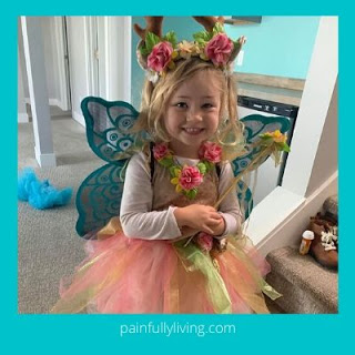 Blond haired young girl wearing fairy costume