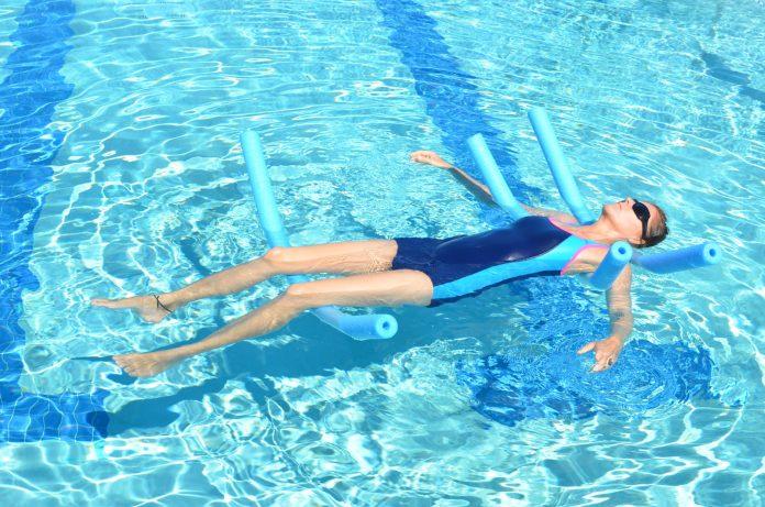 aqua yoga for chronic pain floating meditation with noodles