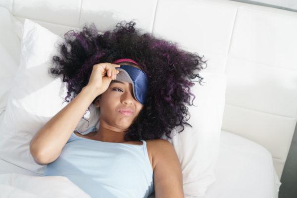 Black woman facing fatigue living with fibromyalgia
