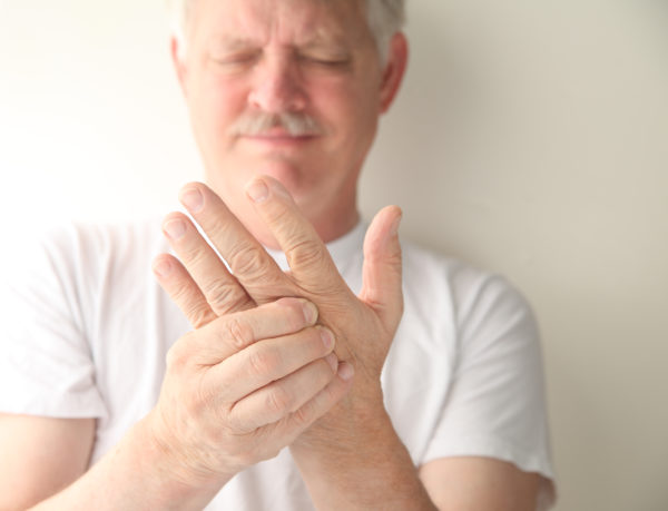 White man with tingling hands living with fibromyalgia