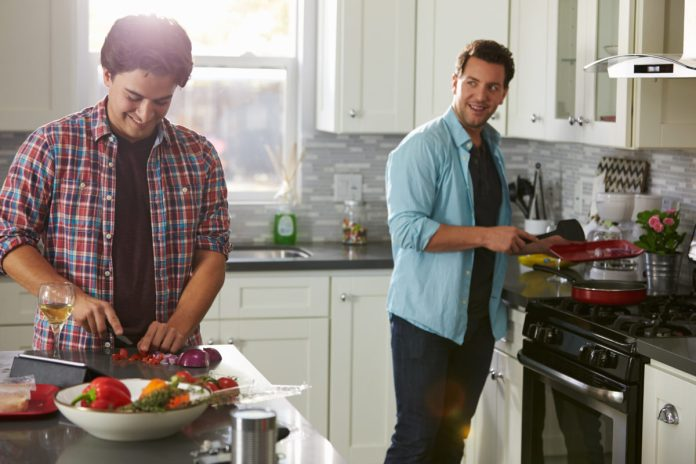 Pain-Friendly Hobbies couple cooking in the kitchen together