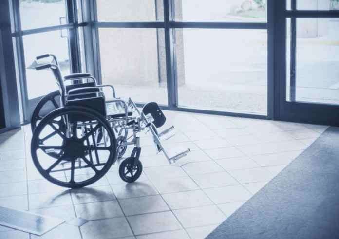 Long Term Disability and Chronic Pain wheelchair in hallway