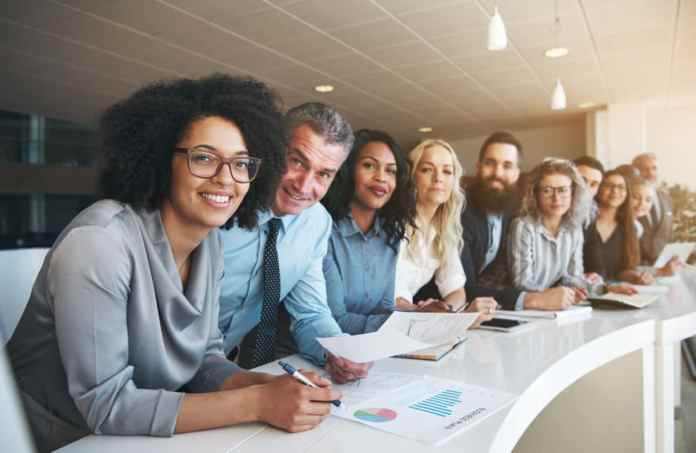 How Chronic Pain Can Affect Job Performance diverse group of coworkers smiling