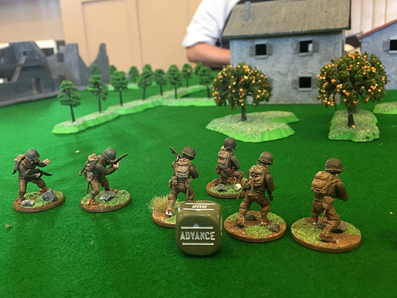 The GI unit advance towards the houses on the right flank