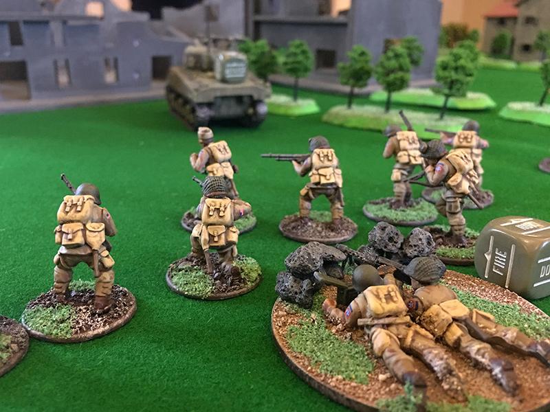 Second US Airborne Squad advance towards the village