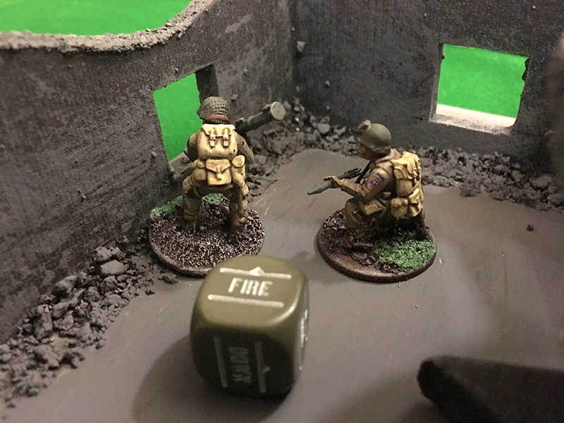 The first Airborne Squad peeks out at the Germans in the house opposite