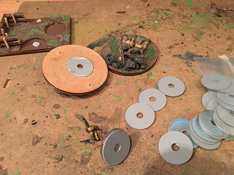 Fixing the washers to the MDF figure bases