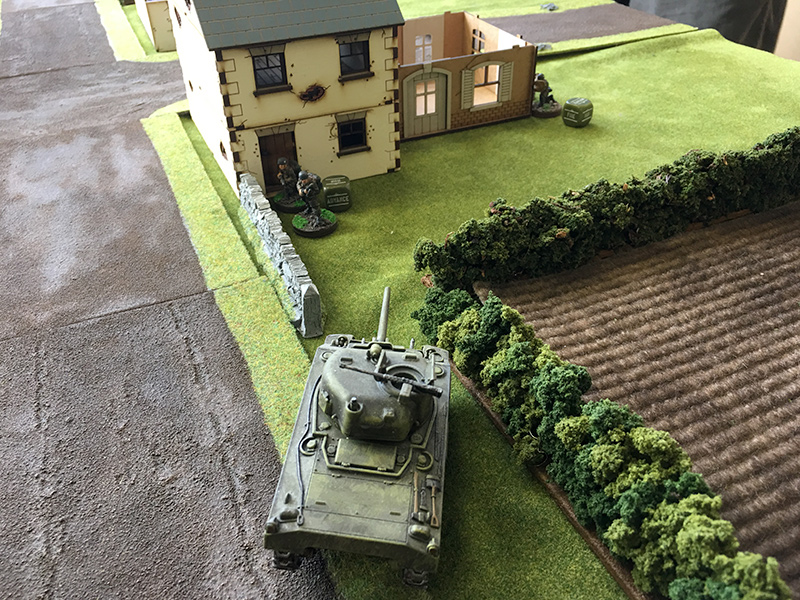 The Sherman trying to machine gun the German flamethorwer