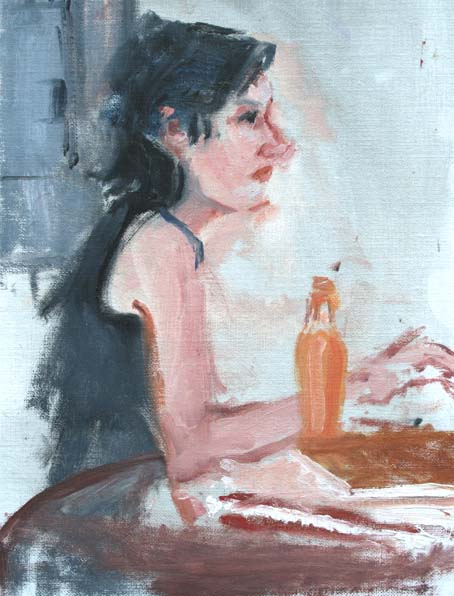 Pretty girl with an orange soda