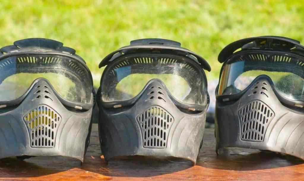 three paintball masks in a line