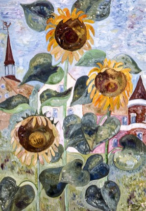 Image of sunflowers with old village buildings behind