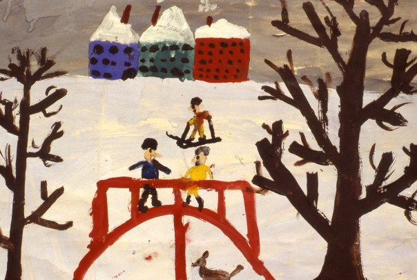 Image of people playing in snow near a bridge