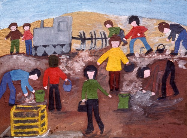 Image of people working in front of a locomotive - perhaps a rail yard