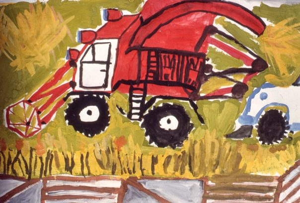 Image of agricultural harvesting machines in a field