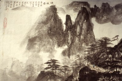Image of steep mountains with Chinese tourists looking on