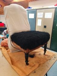 Black fibre in upholstery
