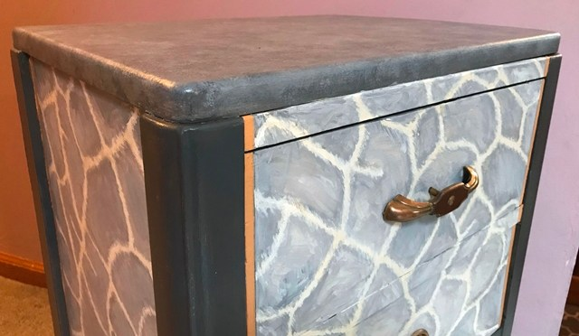 Giraffe Skin in Grey on a Vintage Side Table