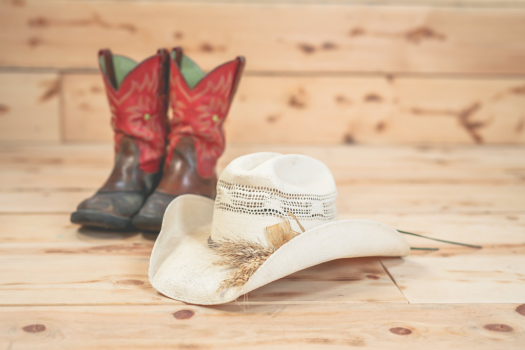 Western hat, boots and wheat