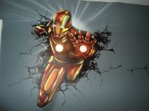 Here is a mural of Iron Man that I painted on a Child's bedroom wall. It was created using regular Airbrush paint by USARTSUPLLY.COM on top of house paint from the paint store.
