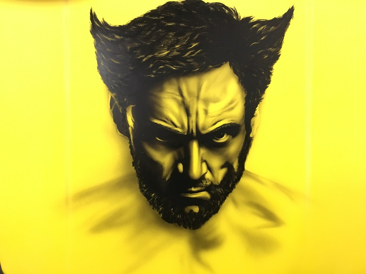 Airbrushing Logan on a car hood, step by step and piece by piece.