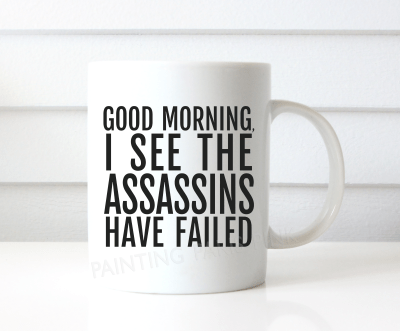 White Ceramic Coffee Mug with the phrase Good Morning, I See The Assassins Have Failed. Available in 11 or 15 ounce