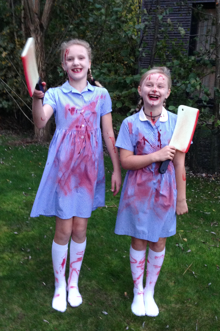 laughing girls dressed as scary grady twins halloween costume