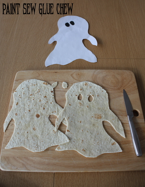 Tortillas cut into ghost shapes