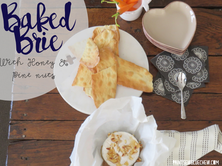 bakes brie with honey and pine nuts