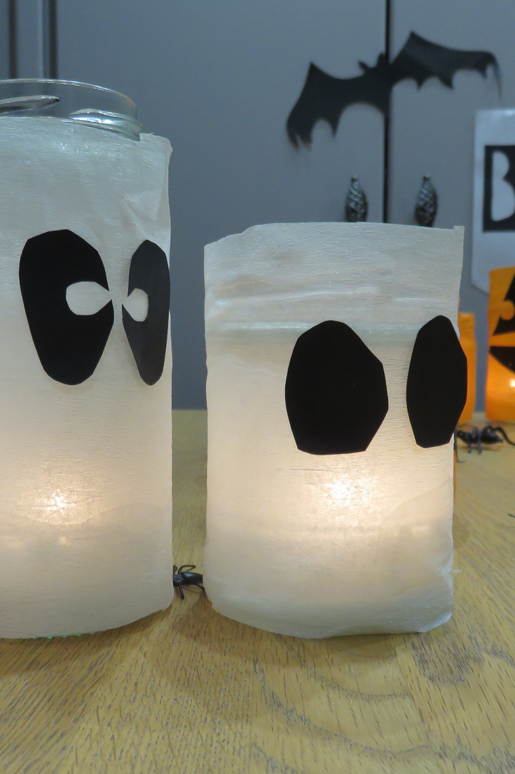 Halloween lanterns made with recycled jam jars for Recycled paper lantern