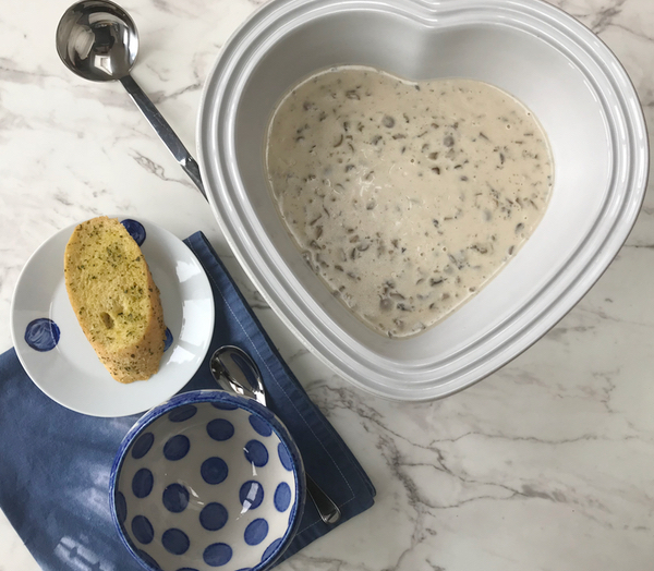 Cream of mushroom soup served in blue bowls with garlic bread